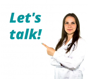 Nurse pointing to sign saying Let's talk!